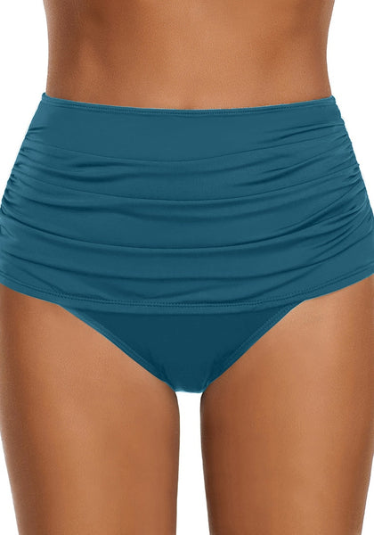 Front view of model wearing blue green high waist ruched swim bottom