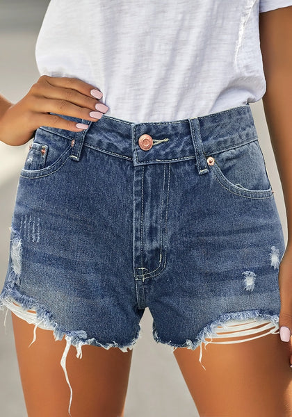 Front view of model wearing blue ripped mid-waist raw hem denim shorts