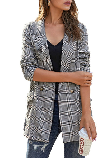 Front view of model wearing brown notch lapel gold button plaid blazer