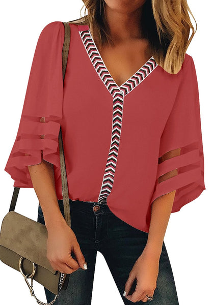 Front view of model wearing coral pink 34 bell mesh panel sleeves V-neckline embroidered top