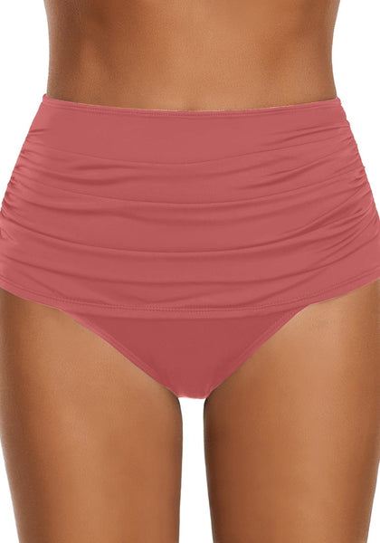 Front view of model wearing coral pink high waist ruched swim bottom