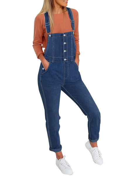 Front view of model wearing dark blue button down skinny denim bib overall jumpsuit