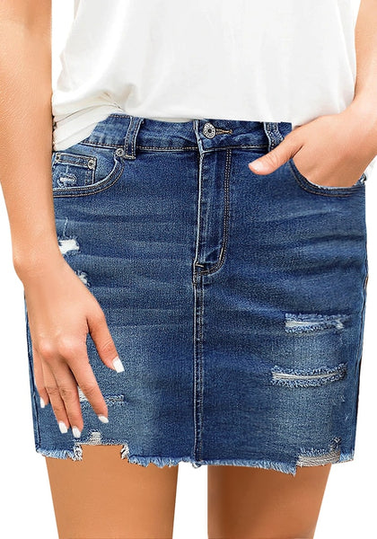 Front view of model wearing dark blue distressed frayed hem denim mini skirt