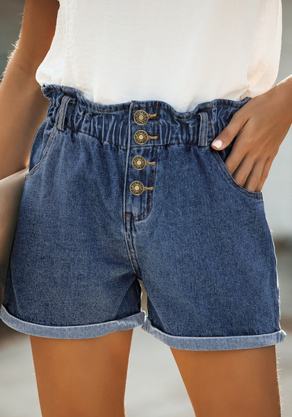 Front view of model wearing dark blue elastic-waist button front roll-over denim shorts