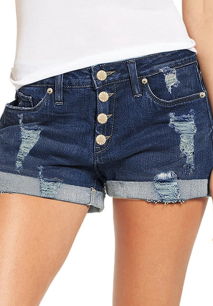 Front view of model wearing dark blue roll-over hem button-up distressed denim shorts