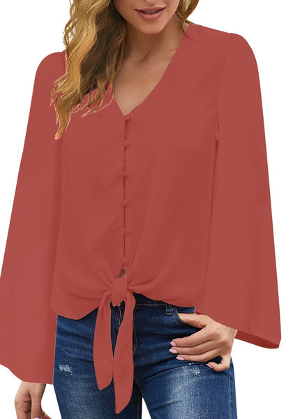 Front view of model wearing dark coral pink V-neckline button loop loose up