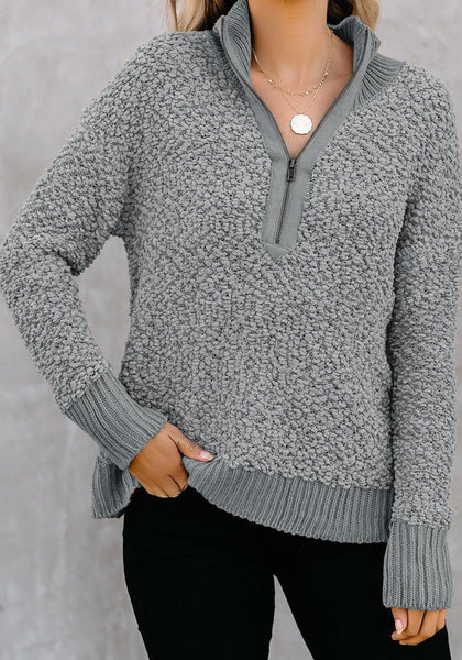 Front view of model wearing grey half-zip turtleneck popcorn fuzzy fleece sweater