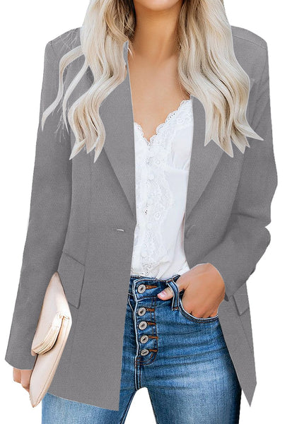 Front view of model wearing grey lapel front-button side-pockets blazer