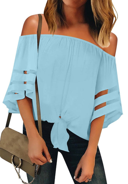 Front view of model wearing light blue 3-4 bell mesh panel sleeves tie-front off-shoulder top