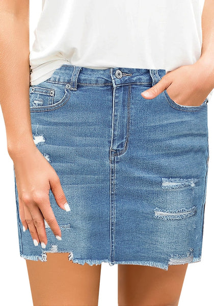 Front view of model wearing light blue distressed frayed hem denim mini skirt
