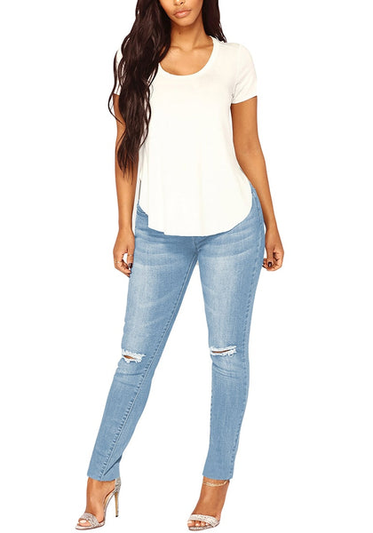 Front view of model wearing light blue drawstring-waist washout ripped skinny jeans