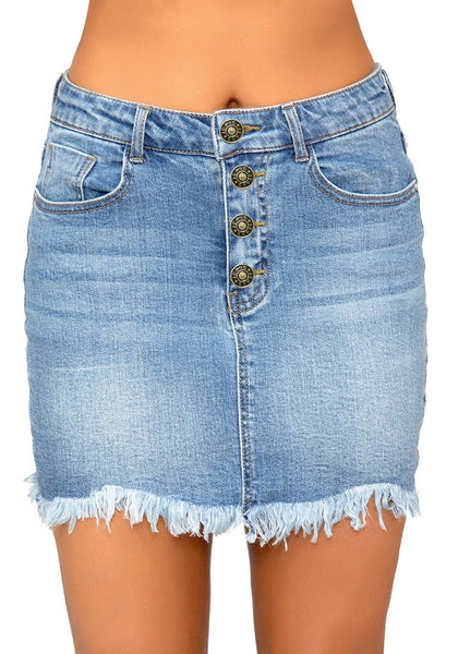Front view of model wearing light blue frayed raw hem buttons denim mini skirt