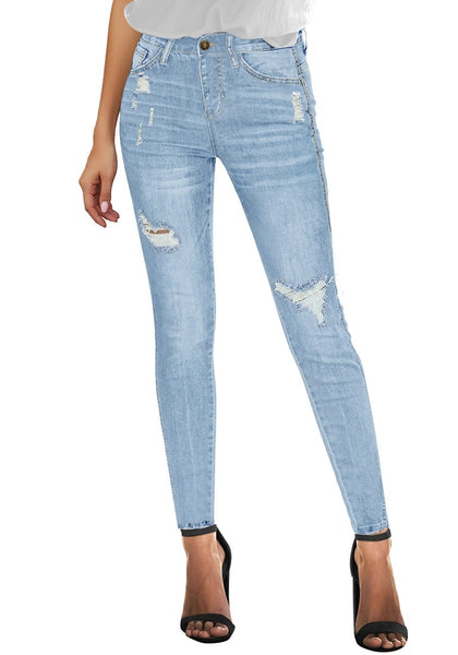 Front view of model wearing light blue high-rise ripped skinny denim jeans