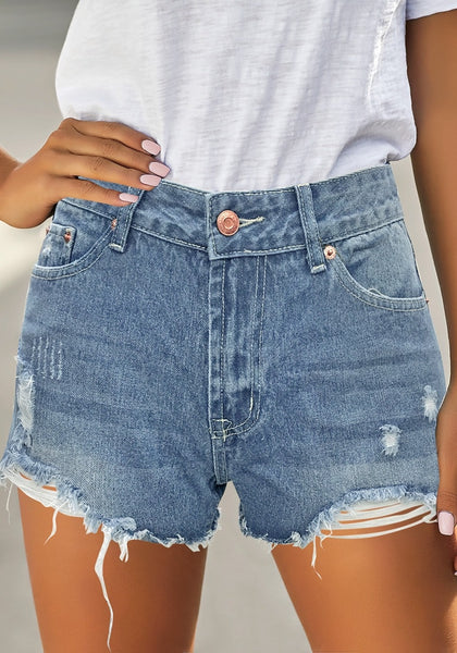 Front view of model wearing light blue ripped mid-waist raw hem denim shorts