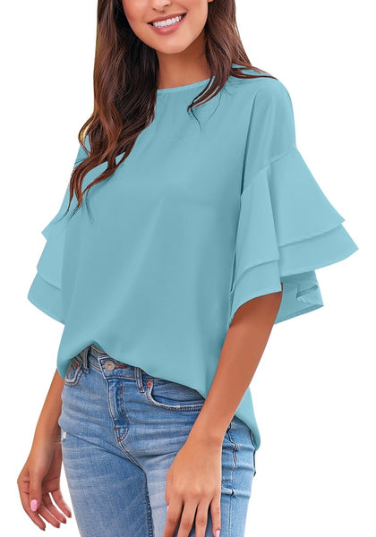 Front view of model wearing light blue trumpet sleeves keyhole-back blouse