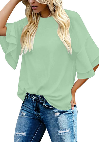 Front view of model wearing mint green trumpet sleeves keyhole-back blouse