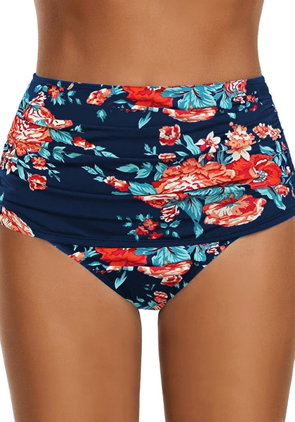 Front view of model wearing navy floral-print high waist ruched swim bottom