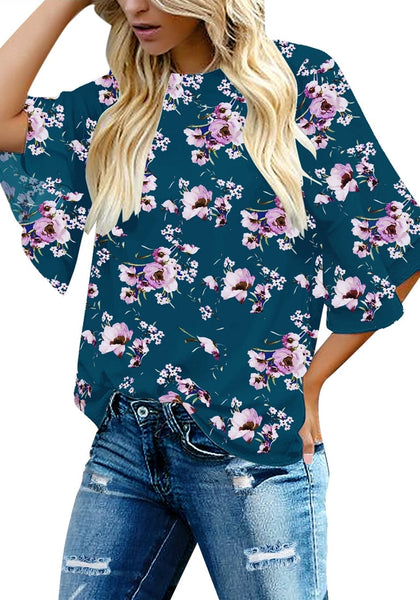 Front view of model wearing navy trumpet sleeves keyhole-back floral blouse