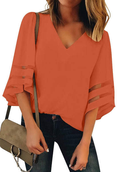 Front view of model wearing orange 34 bell mesh panel sleeves V-neckline loose top