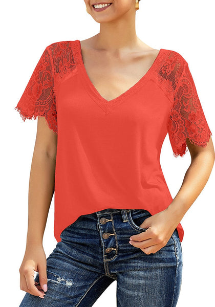 Front view of model wearing orange crochet lace short sleeves striped V-neckline top