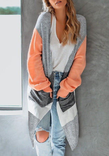 Front view of model wearing orange open-front colorblock oversized long knit cardigan