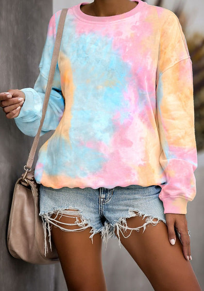 Front view of model wearing pink and yellow tie-dye drop shoulder pullover sweater