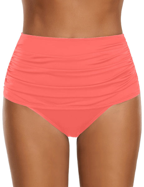 Front view of model wearing salmon high waist ruched swim bottom