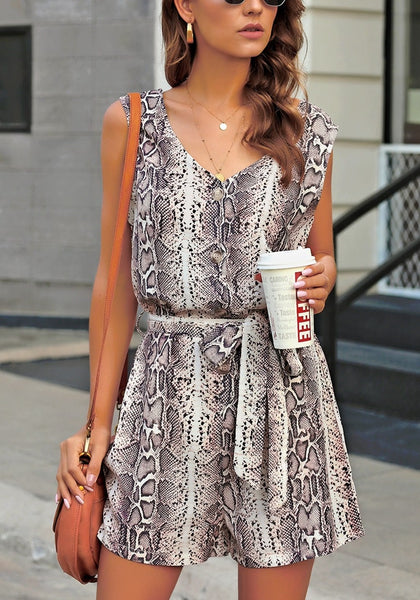 Front view of model wearing snake pattern V-neck sleeveless belted romper
