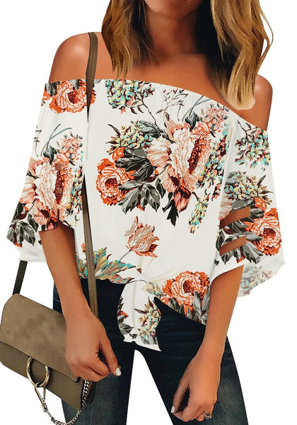 Front view of model wearing white 3-4 bell mesh panel sleeves tie-front off-shoulder floral top