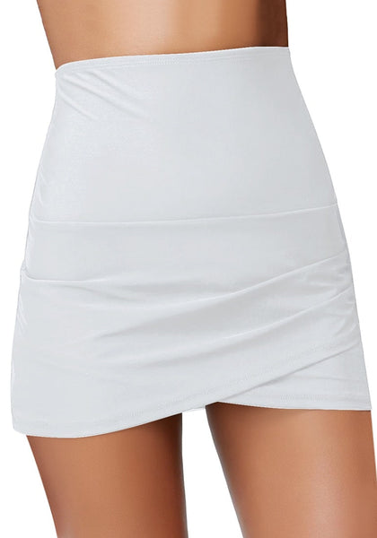 Front view of model wearing white tulip hem high waist ruched swim skirt