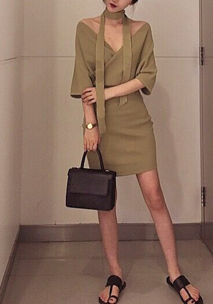 Full Front view of model in khaki wrap pencil dress