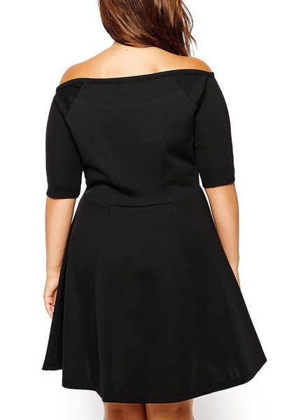 Back shot of model in black off-shoulder skater dress