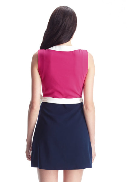 Full back shot of model in pink and navy sleeveless wrap-style dress