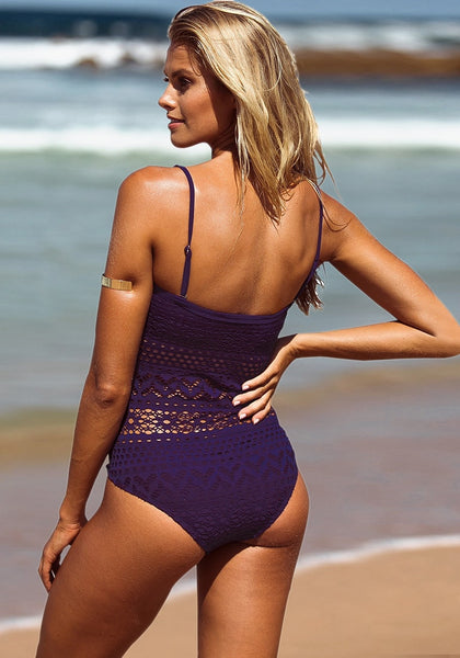 Full back shot of model in purple lace halter swimsuit