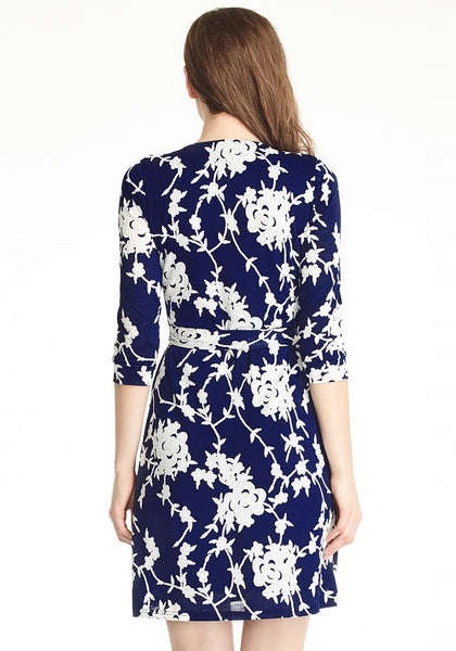 Full back shot of navy blue floral plunge wrap dress on model