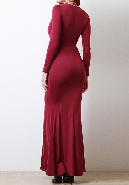 Full back side shot of model in a burgundy lace-up long dress