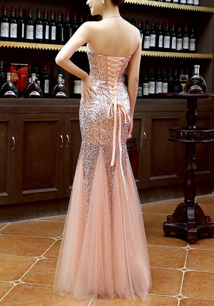 Full back side view of model in peach sequin mermaid evening gown