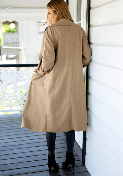 Full back view of girl in camel draped open-front long coat