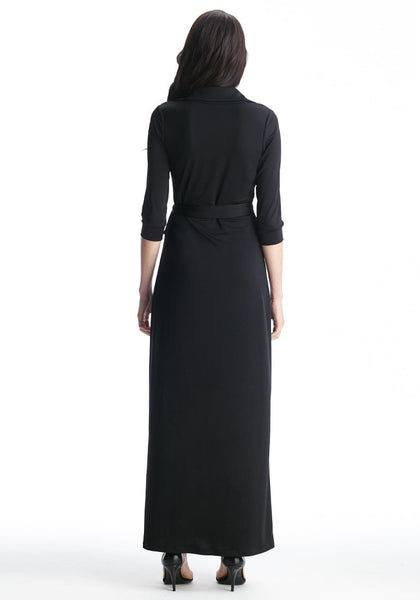 Full back view of model in black plunge wrap belted maxi dress