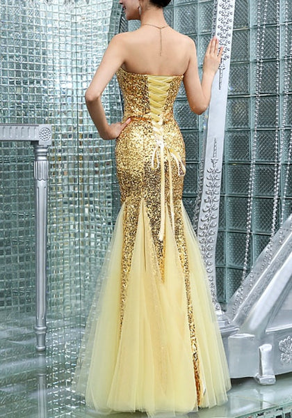 Full back view of model in gold sequin mermaid evening gown