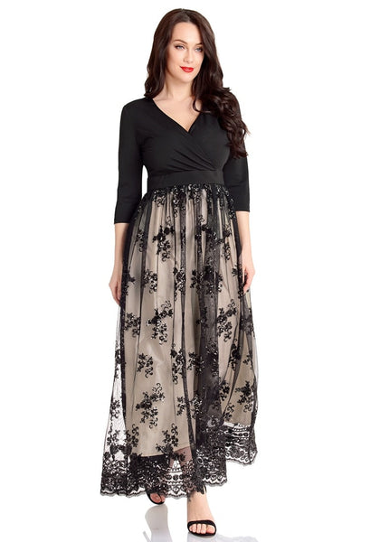 Full body angled shot of model in plus size black mesh floral sequin maxi  skater dress