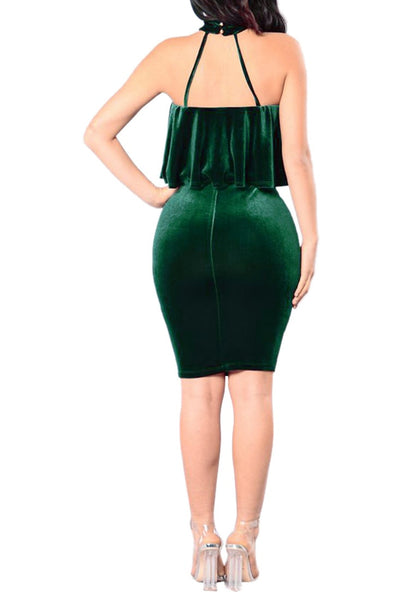 Full body back shot of model in green velvet ruffled tube choker dress