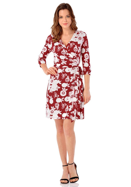 Full body front shot of model wearing maroon floral plunge wrap dress