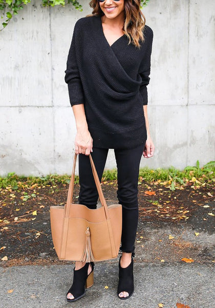 Full body front shot of woman in black ribbed wrap sweater