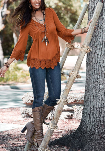 Full body front shot of woman in brown padded shoulder lace-trim blouse