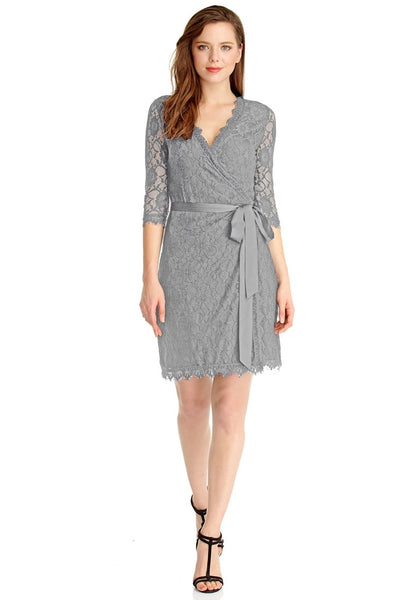 Full body front shot of woman wearing grey lace overlay plunge wrap-style dress