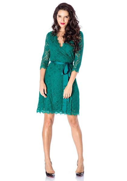 Full body front view of model in teal lace overlay plunge wrap-style dress
