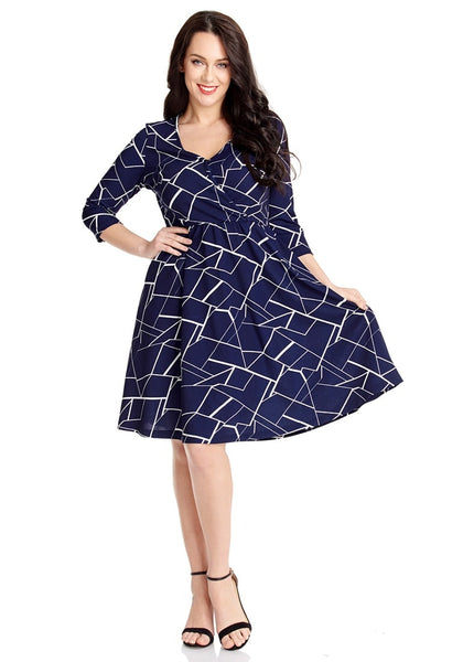 Full body front view of model wearing plus size navy geometric-print crop sleeves faux wrap dress