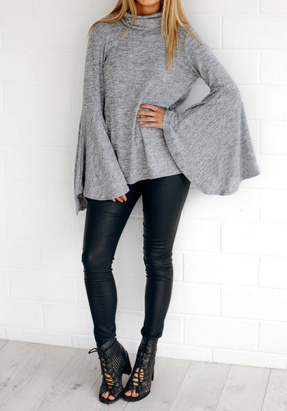 Full body shot of lady wearing grey bell-sleeved back-slit top