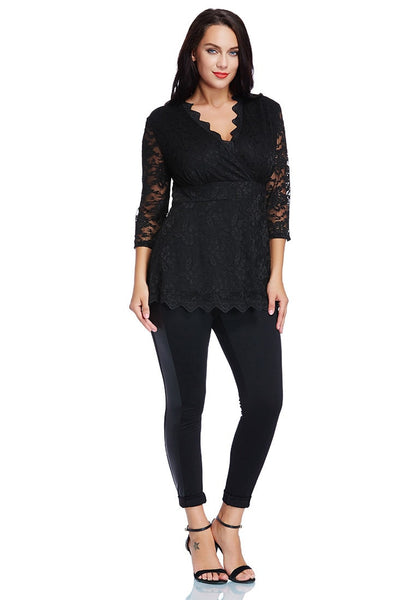 Full body shot of lady wearing plus size black lace scallop blouse